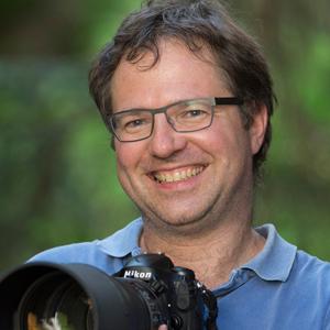 olaf krüger fotograf mit kamera portrait